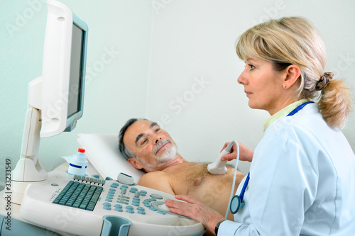 Senior patient getting ultrasound from doctor