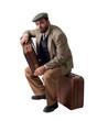 Emigrante seduto sulle valigie