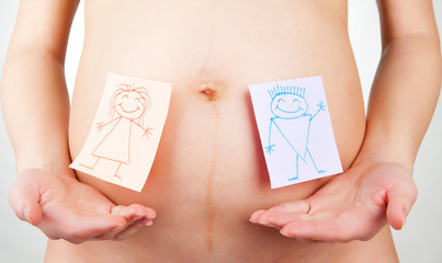 Paper stickers on pregnant woman abdomen