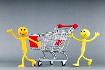 Happy family with shopping cart