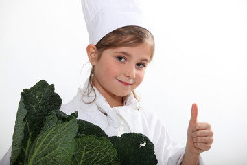Child cook with cabbage