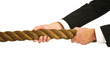 businessman gripping rope