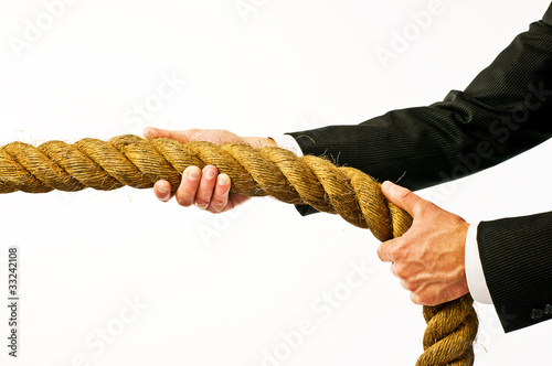 businessman holding rope
