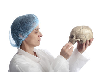 archeology female researcher analysing a skull