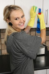 Happy Housewife Cleaning Kitchen