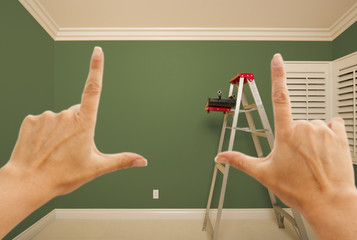 Hands Framing Green Painted Wall Interior