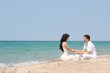young loving couple on beach
