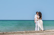 young loving couple on sea background