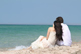 young couple dreaming on beach