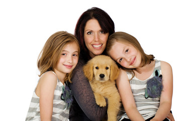 a pretty mom, her kids and a puppy