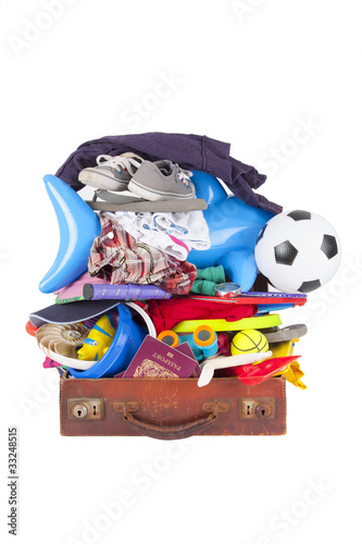 summer vacation or holiday suitcase really packed, cannot close