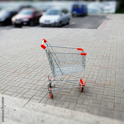 Empty shopping cart in parking