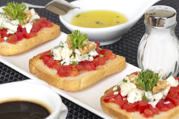 Appetizers with tomatoes and cheese decorated with parsley