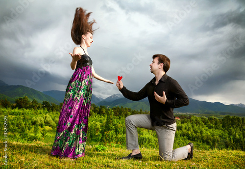 Man gifting heart to his girlfriend