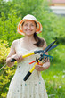 Mature woman with garden tools