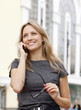 Young business woman talking by phone