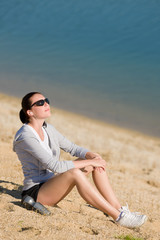 Summer sport fit woman relax on beach