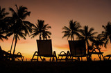 Row deckchairs on beach at sunset, Tanjung Aru, Malaysia