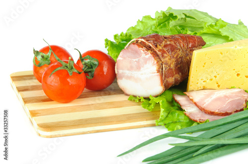 Arrangement with meat smoked bacon, tomatoes and cheese