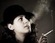Woman smoking a cigarette - black and white