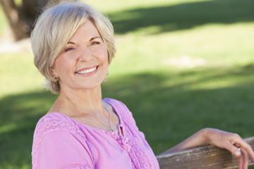 Happy Senior Woman Sitting Outside Smiling