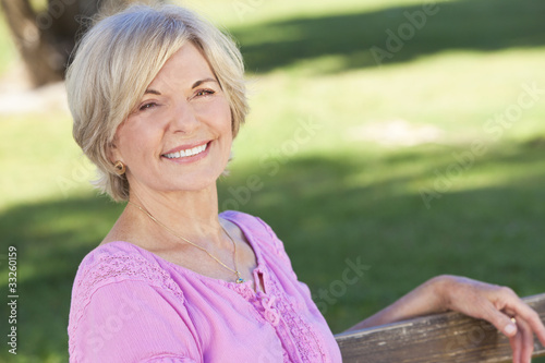 Happy Senior Woman Sitting Outside Smiling