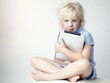Cute blond girl loves her touchpad so much