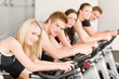Fitness group of people on gym bike