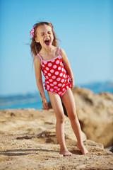 Child at beach in summer