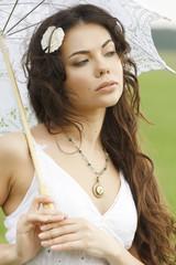 Pretty girl with white umbrella