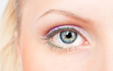 Eye with pink and green make-up