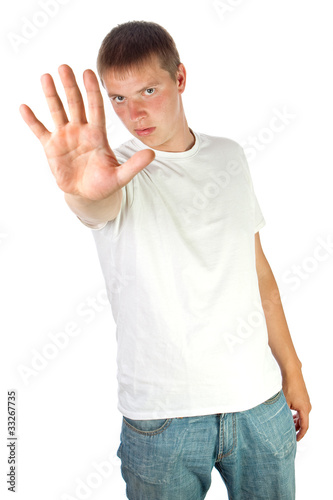 Young man making stop sign with his hand