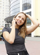 Young business woman talking by telephone