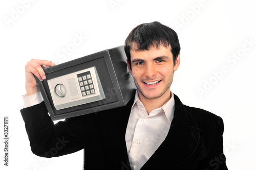 Portrait of young businessman holding metal safe
