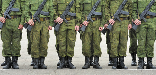 formation of soldiers with guns