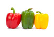 Three sweet peppers in yellow, red and green color
