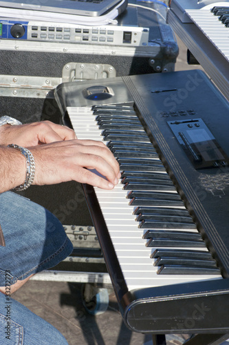 Detail of keyboardist's hands during a concert