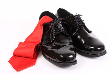 Shiny men's dressy shoes and red tie