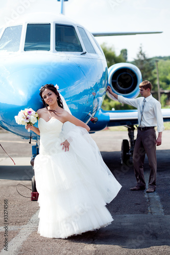 Wedding couple fly on honeymoon