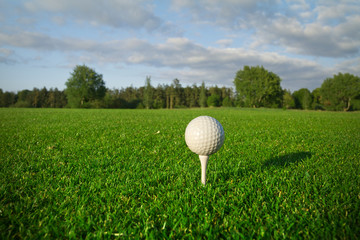 Golf ball on the tee - idyllic golf course of Adare