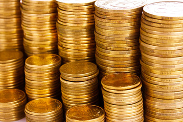 Many coins in columns isolated on white. Ukrainian coins
