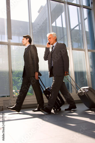 two businessman with trolley