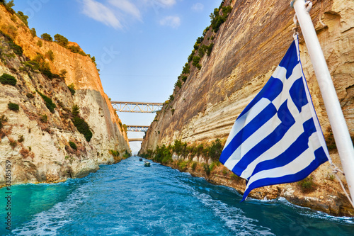 Corinth channel in Greece and greek flag on ship - 33285159