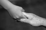 child holding old woman hand
