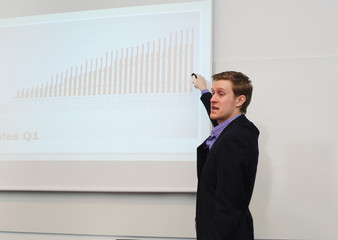 Young businessman holding a presentation.