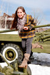 Постер, плакат: woman in a museum of military equipment