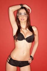 Young sexy brunette in silver plastic glasses