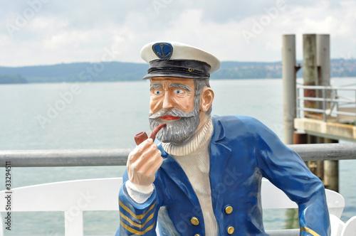 Leinwanddruck Bild Kapitänsfigur einer Schifffahrtsgesellschaft am Bodensee