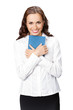Happy smiling young business woman with notepad, isolated