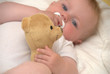 Baby wiht teddy and pacifier